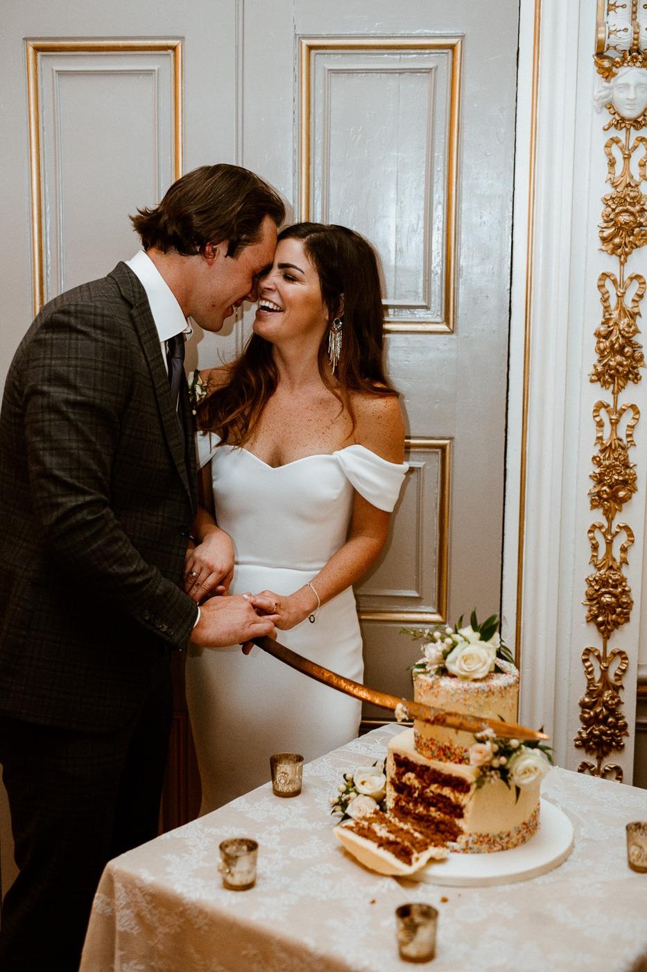 A person cutting a cake