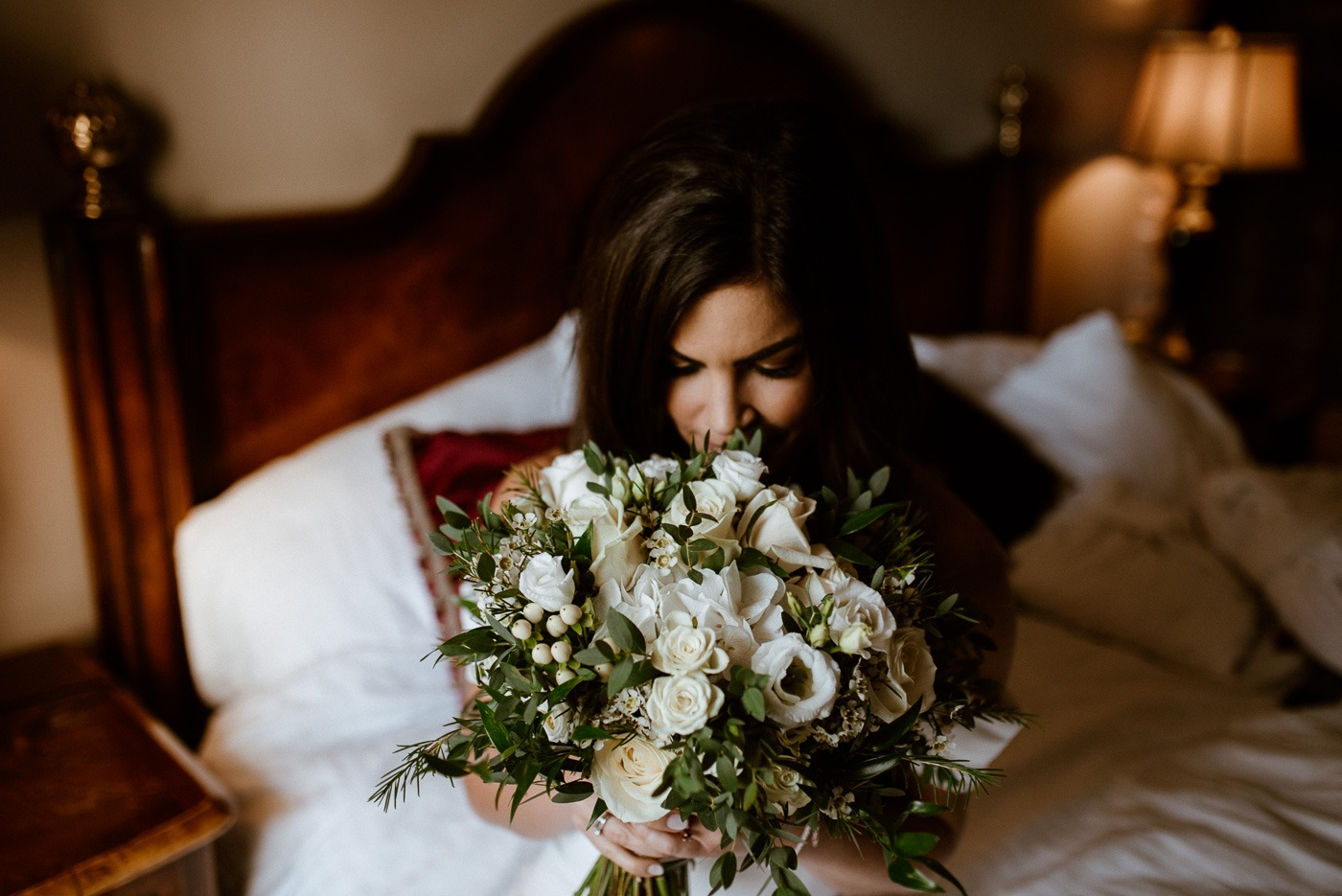 A person sitting at a table with a flower on a bed