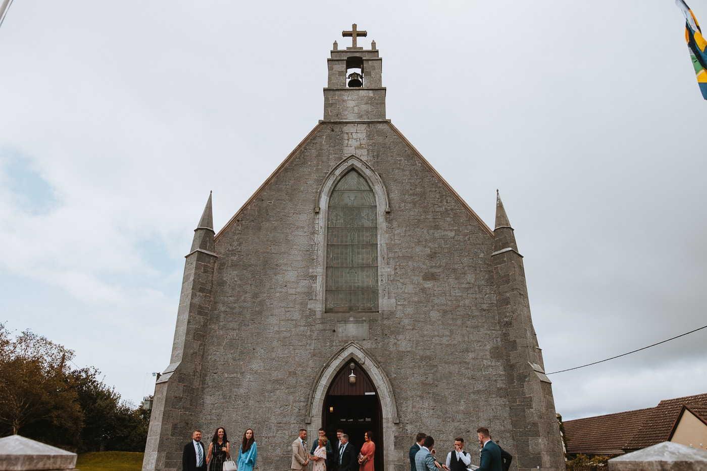 A group of people standing in front of a church