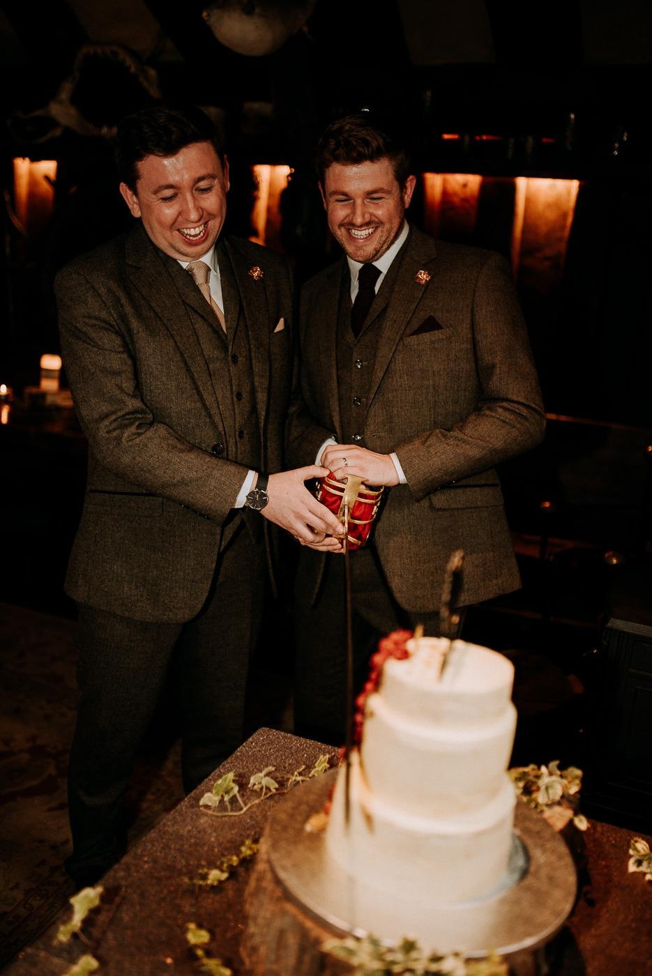 Oleg Frish and woman cutting a wedding cake