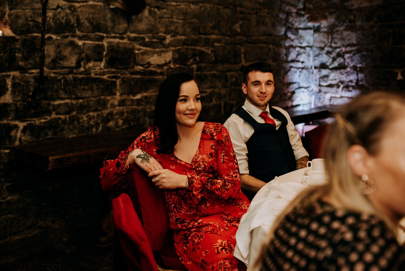 A man and a woman in a red dress