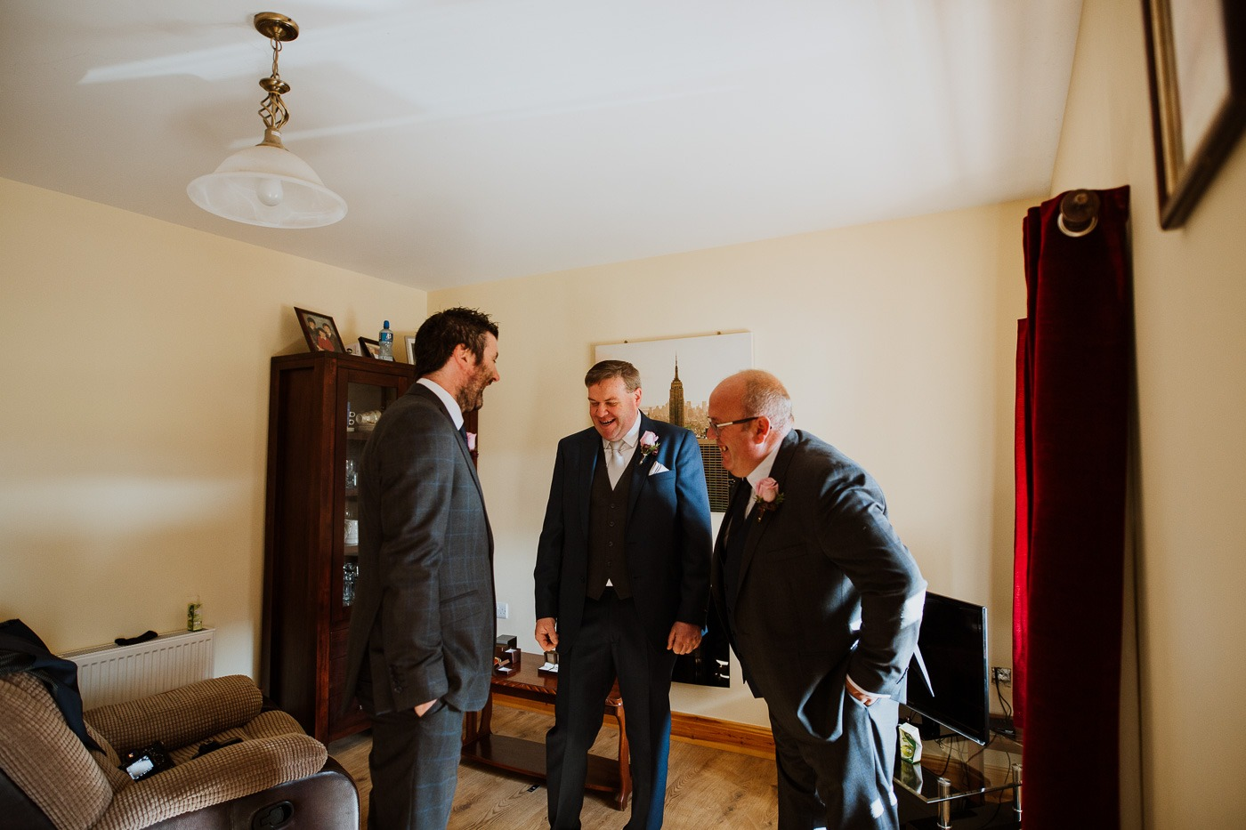 A man in a suit and tie standing in a room