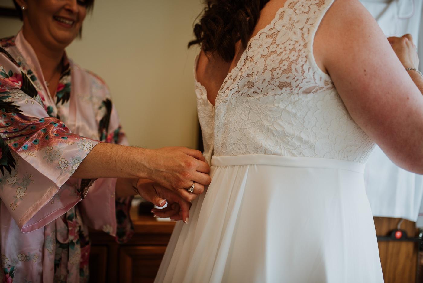 A woman cutting a wedding cake