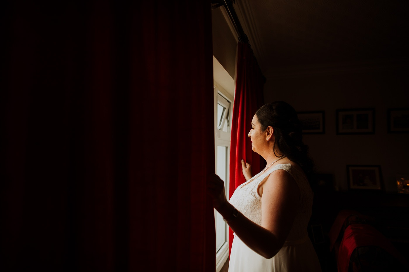 A woman standing in a dark room