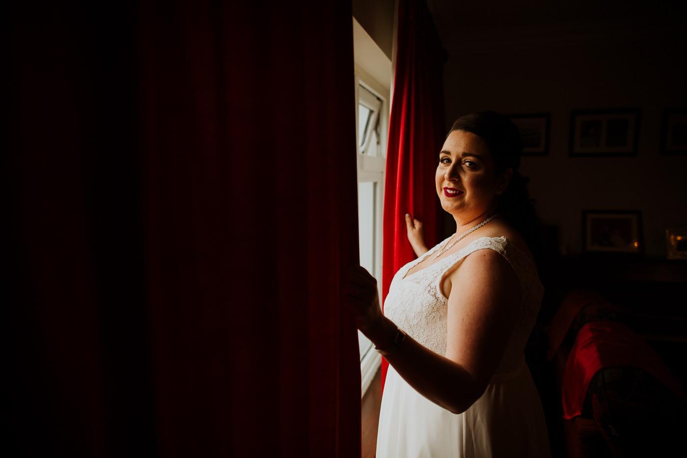A woman standing in front of a door