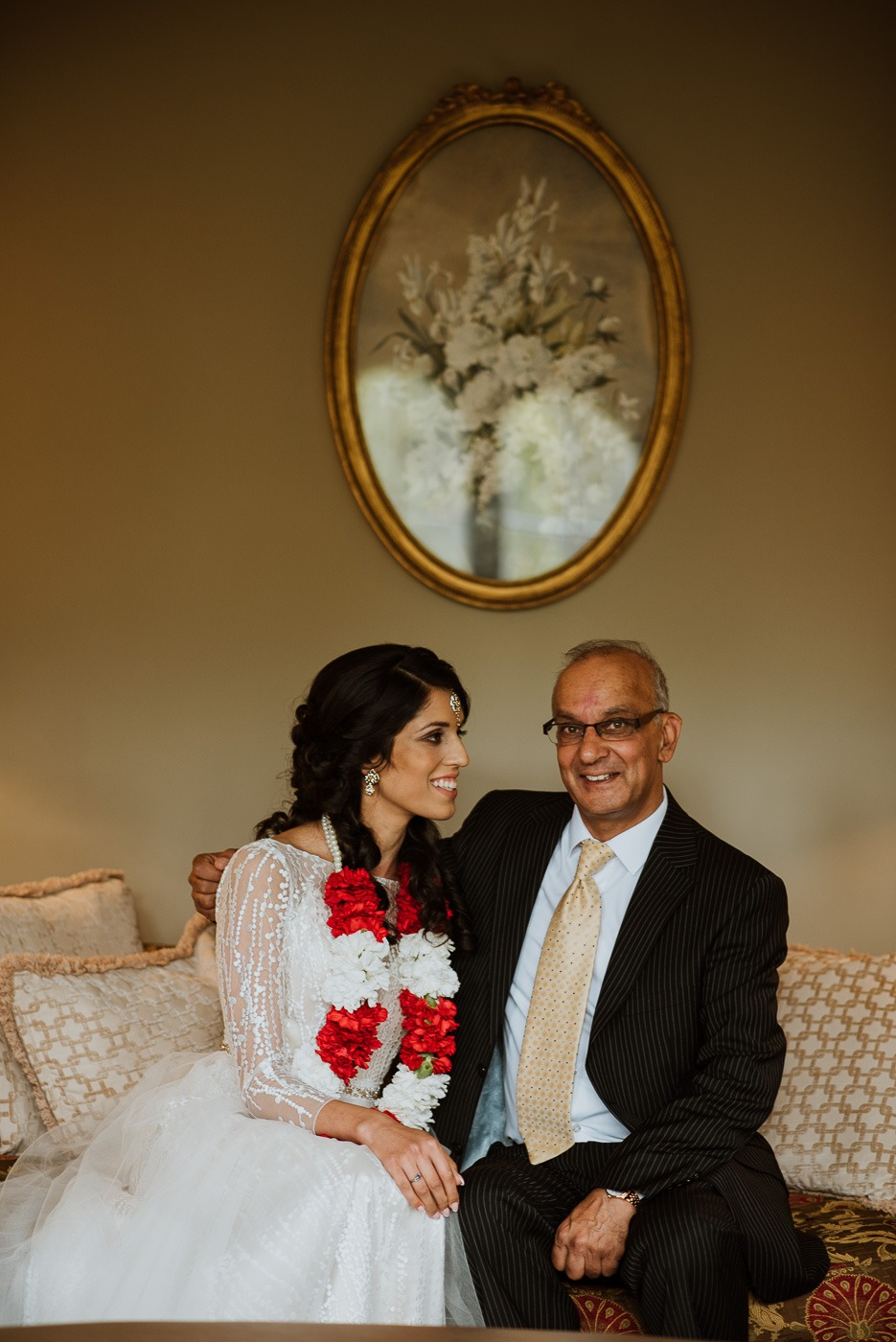 A man and woman sitting in front of a mirror posing for the camera