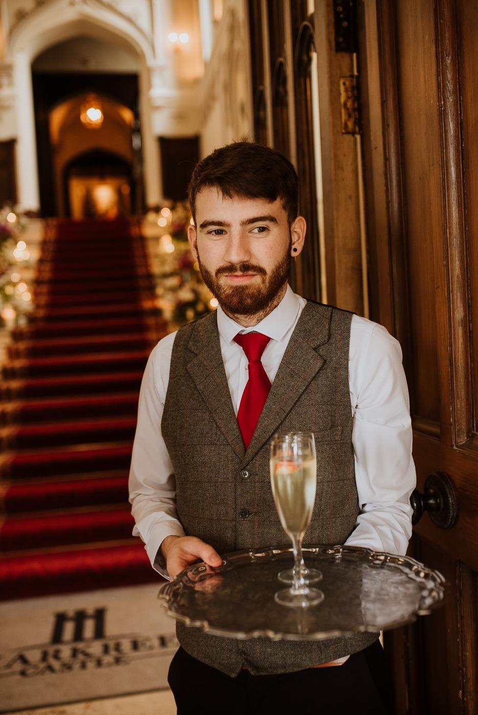 Neil Jones wearing a suit and tie