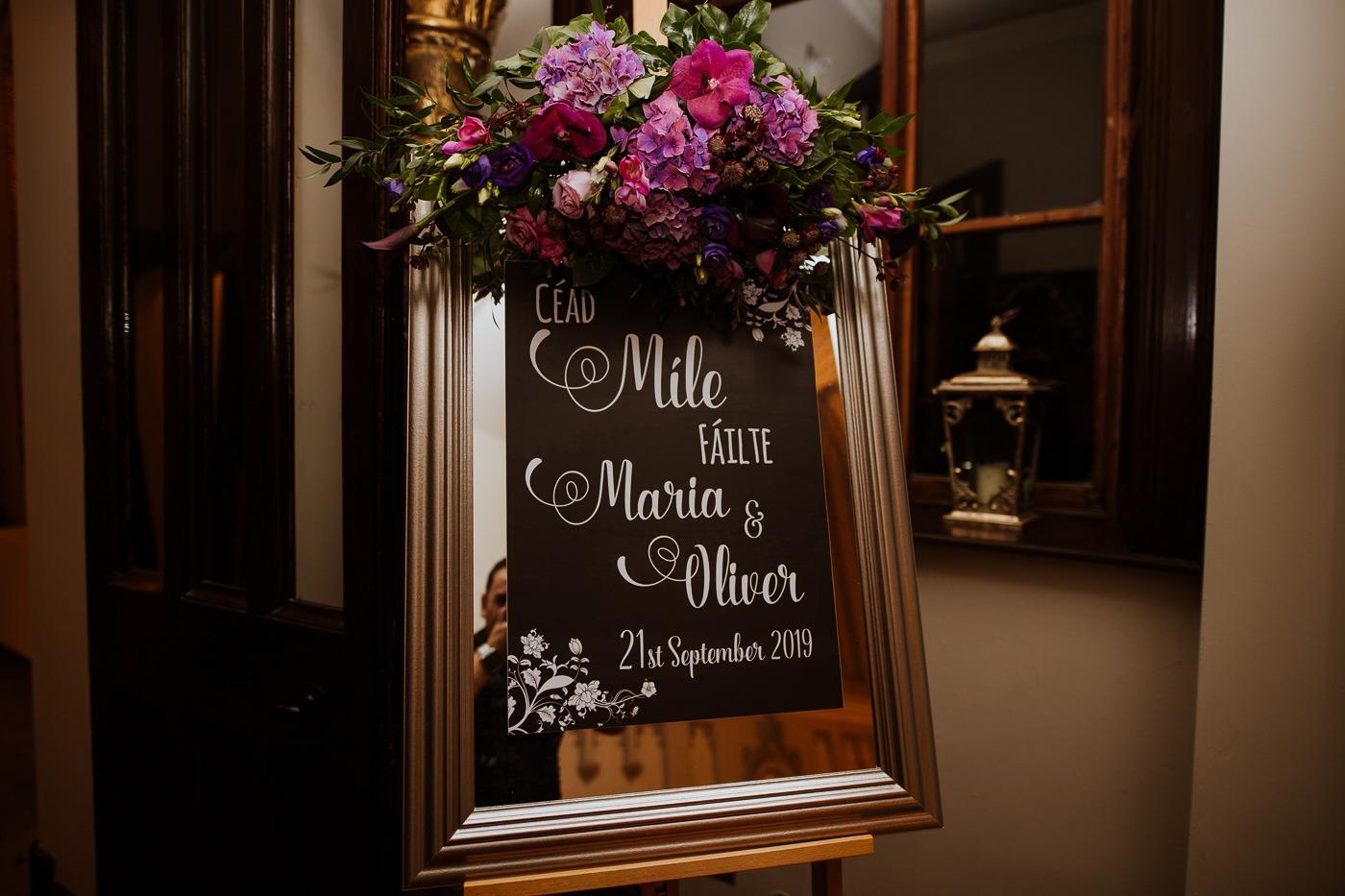 A vase of flowers sitting in a dark room