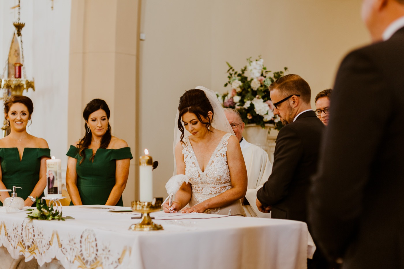 A group of people sitting at a table with a cake