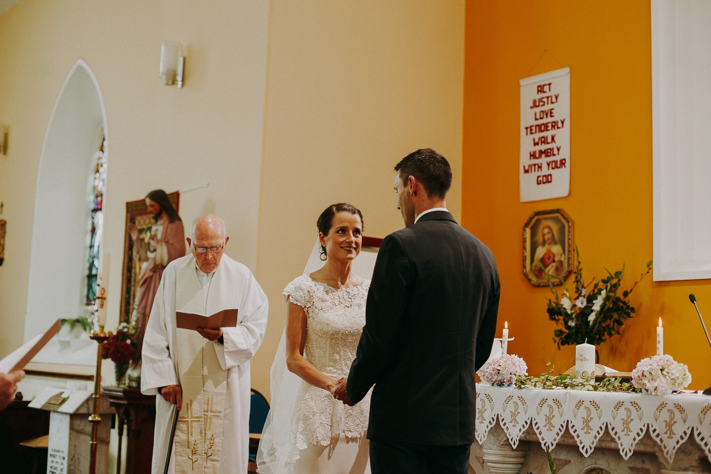 A man and a woman standing in front of a wedding cake