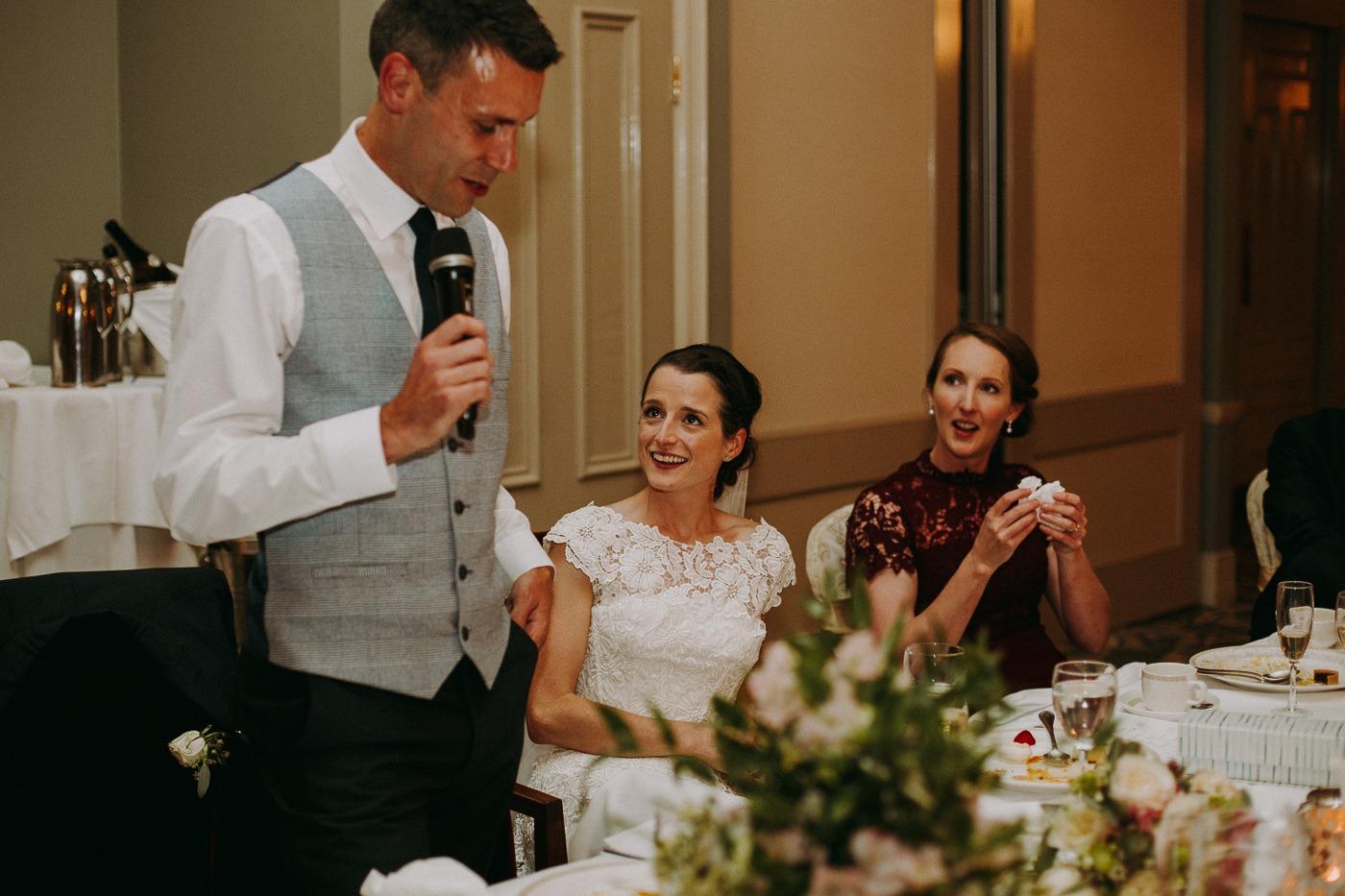 Leonora Kennedy et al. that are cutting a wedding cake