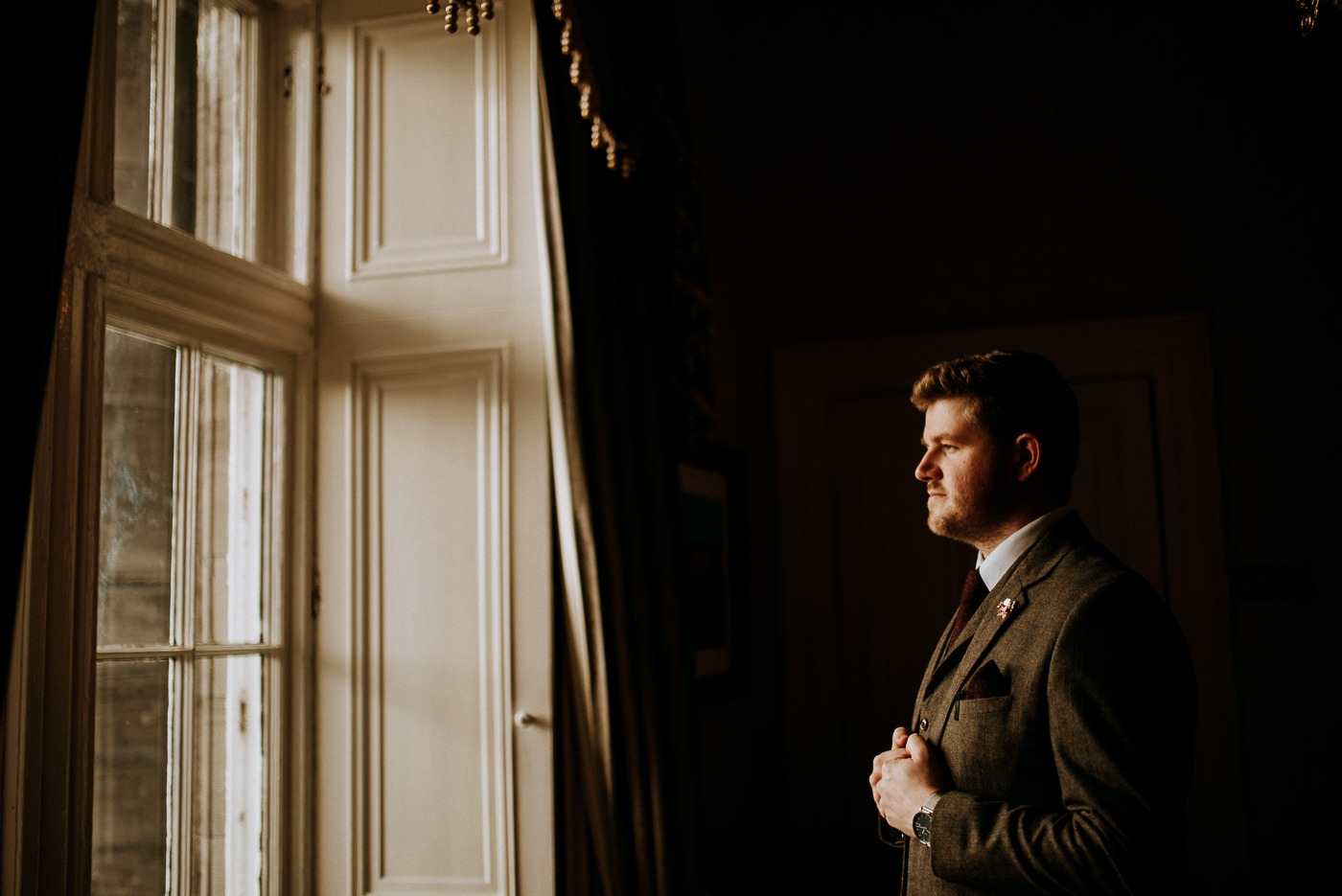 A man standing in front of a window