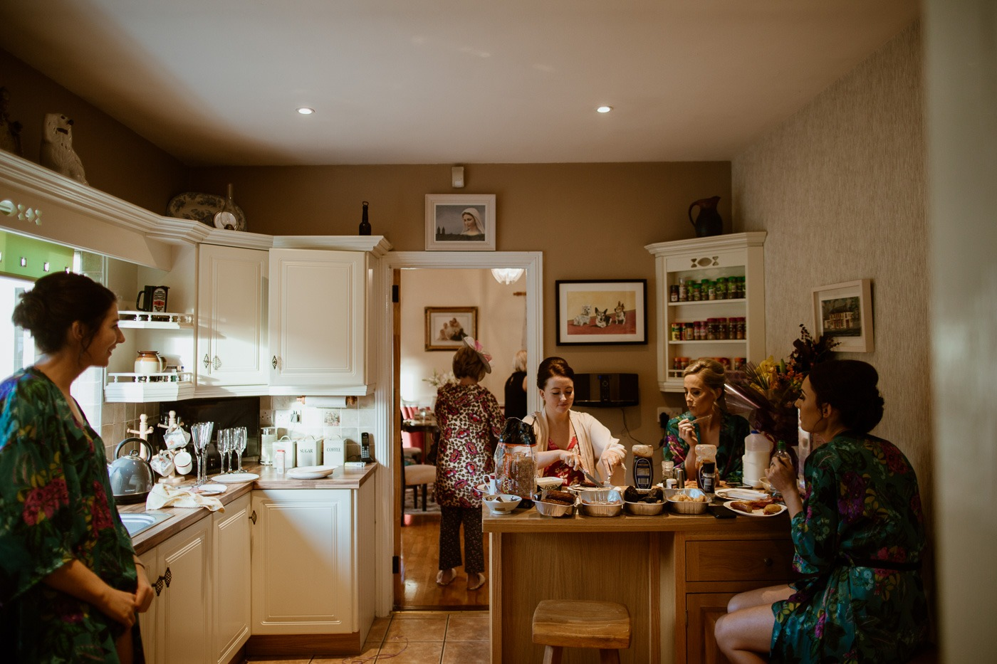 A group of people in a kitchen
