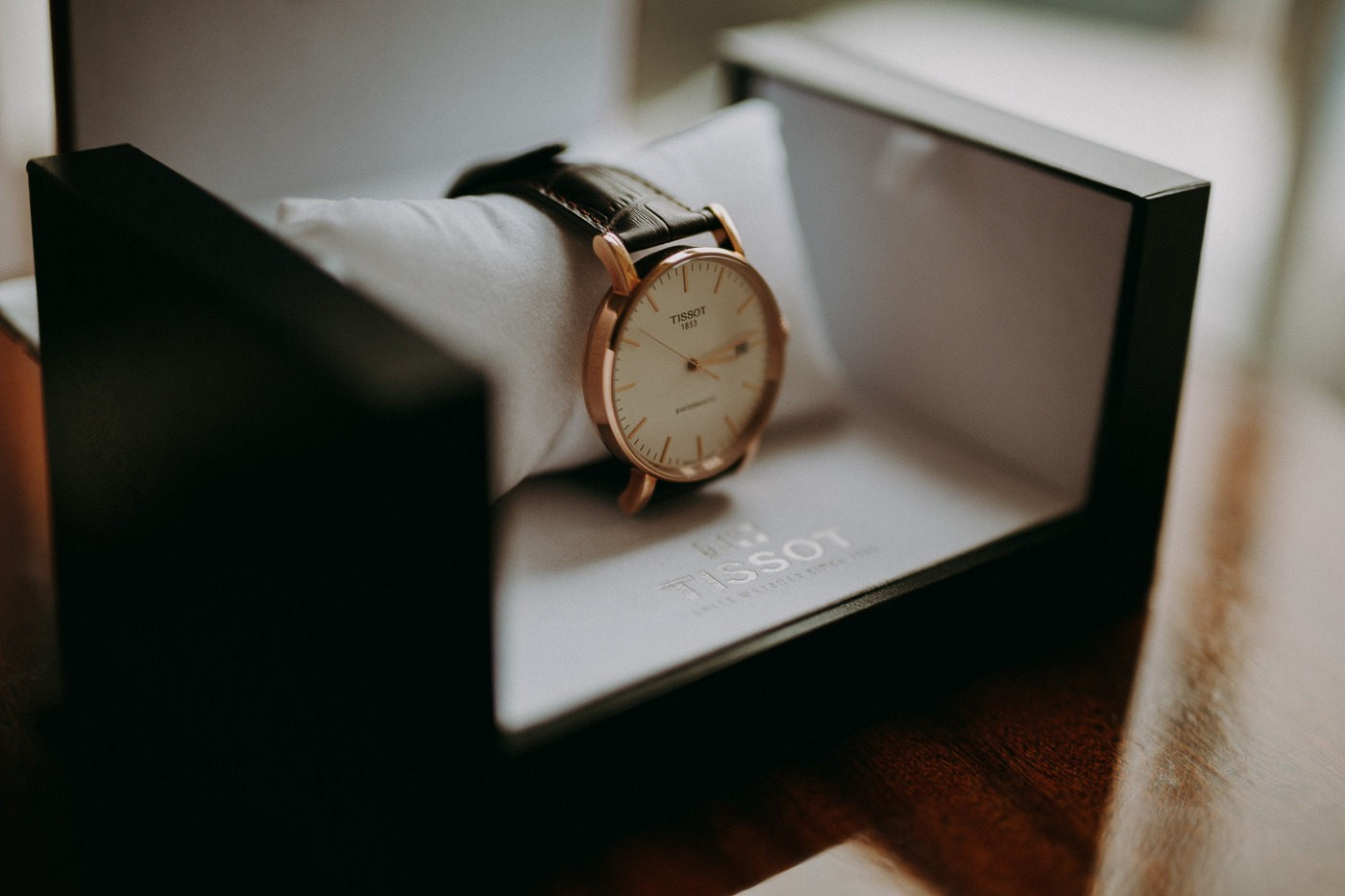 A small clock sitting on top of a desk