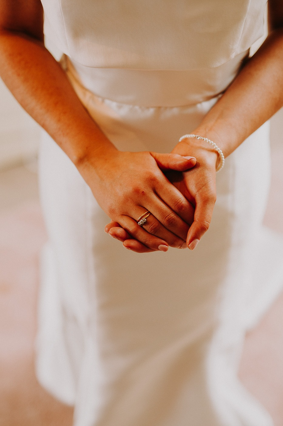 A hand holding a piece of paper
