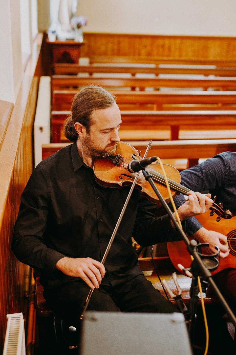 A man holding a violin