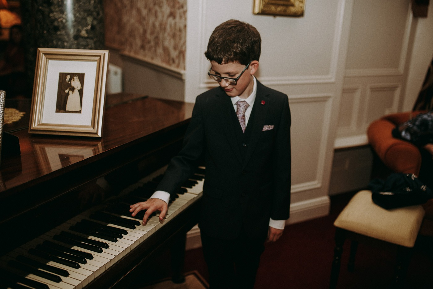A man standing in front of a piano