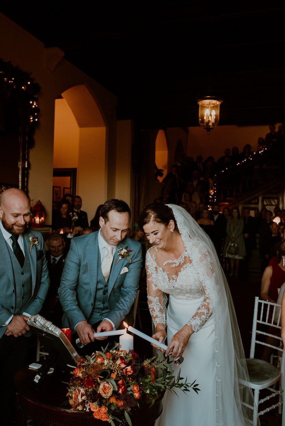 A man and woman cutting a wedding cake