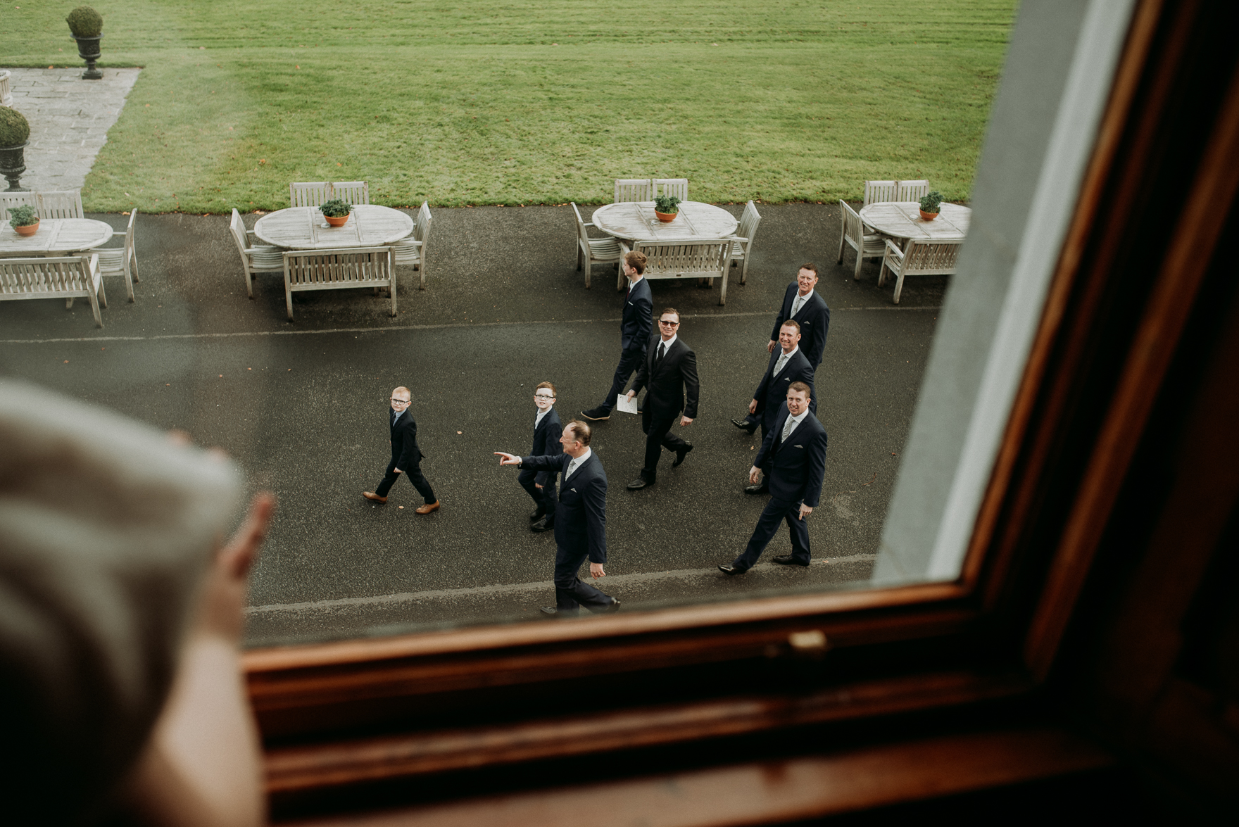 A group of people walking in front of a mirror