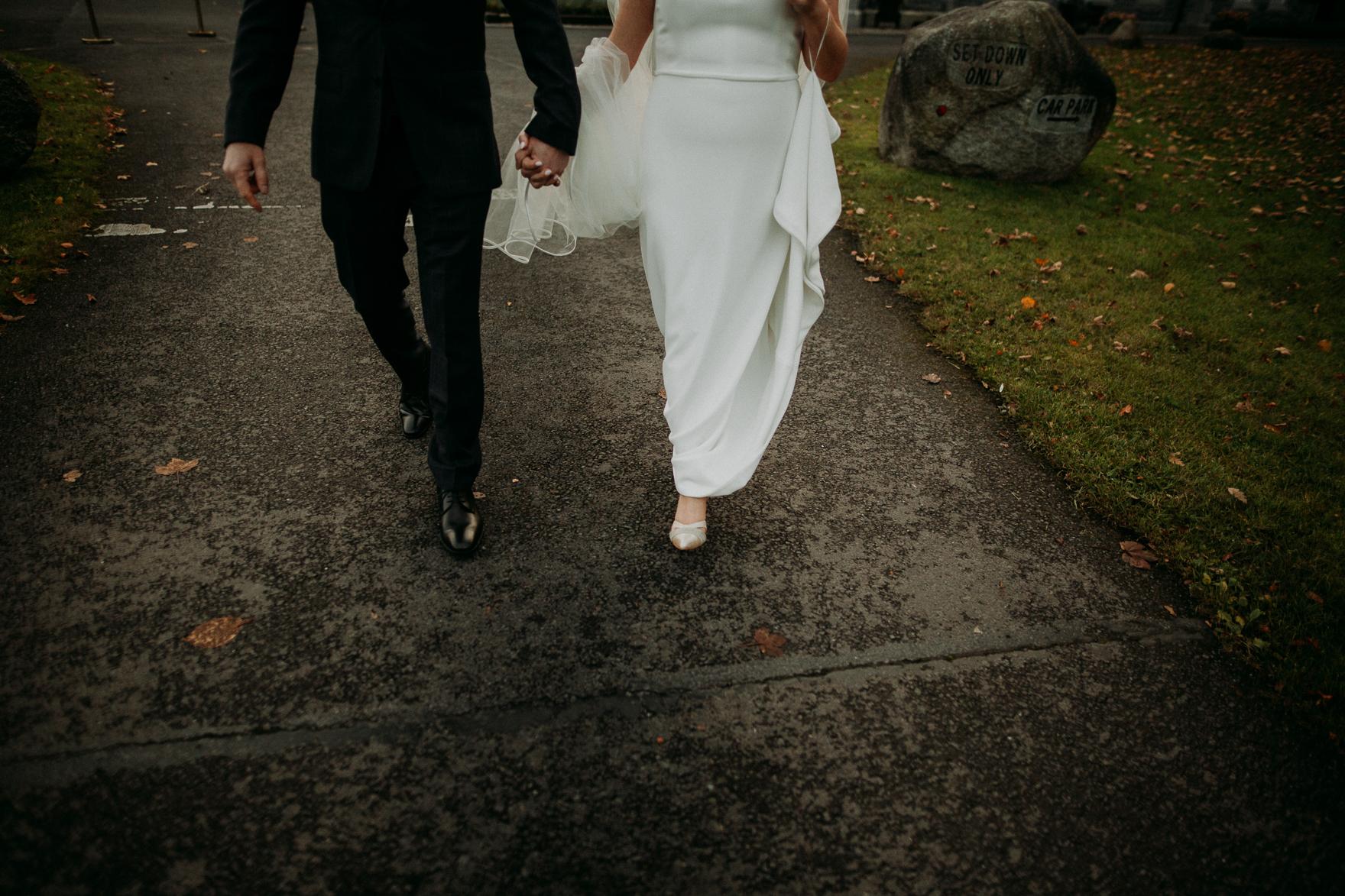 A man and a woman walking down a sidewalk