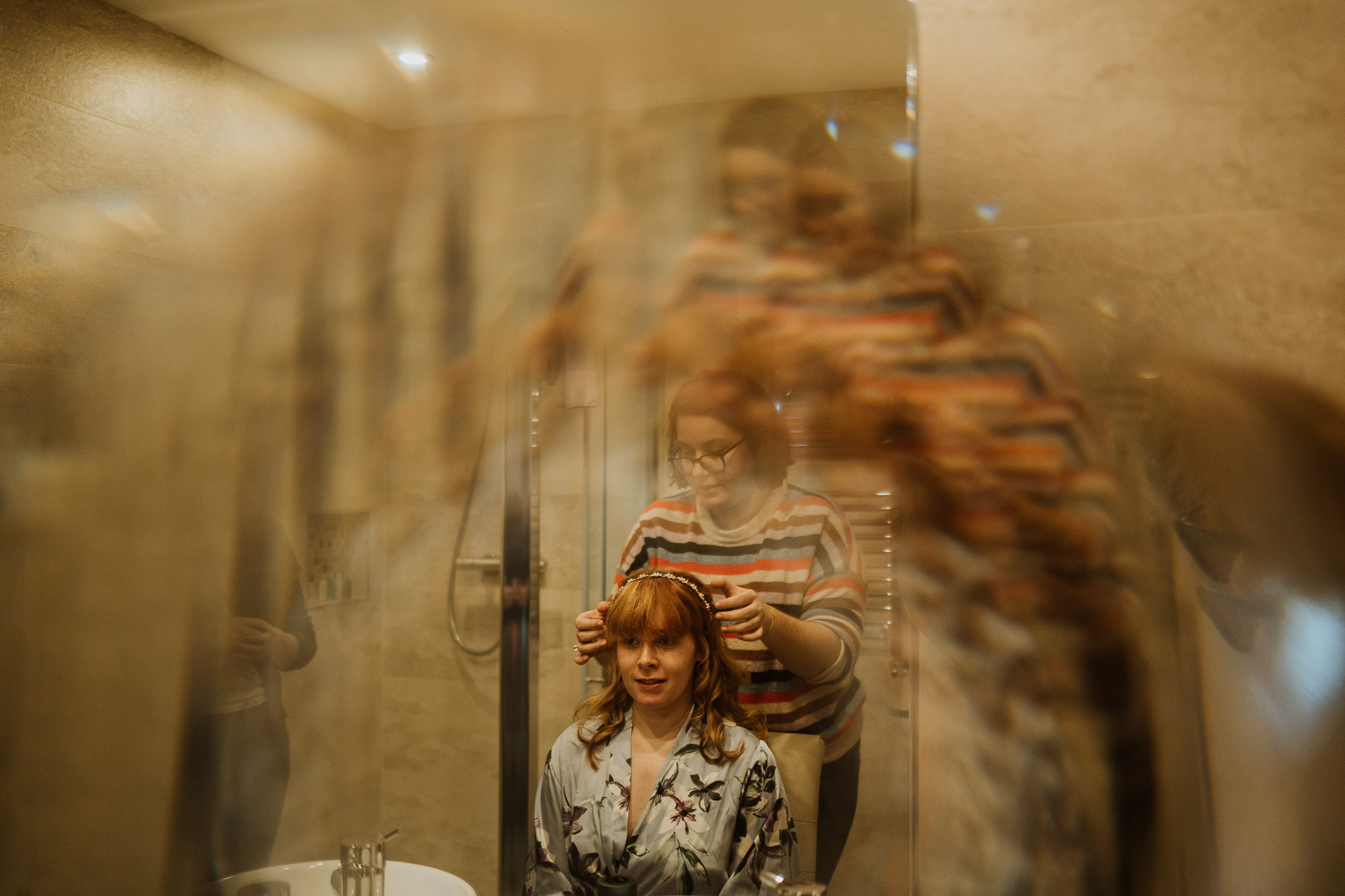 A person standing in front of a mirror posing for the camera