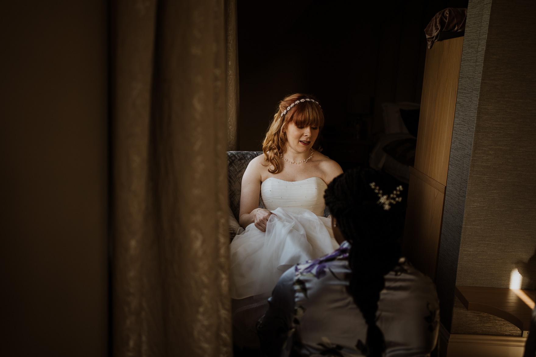Rachel Steele sitting on a suitcase