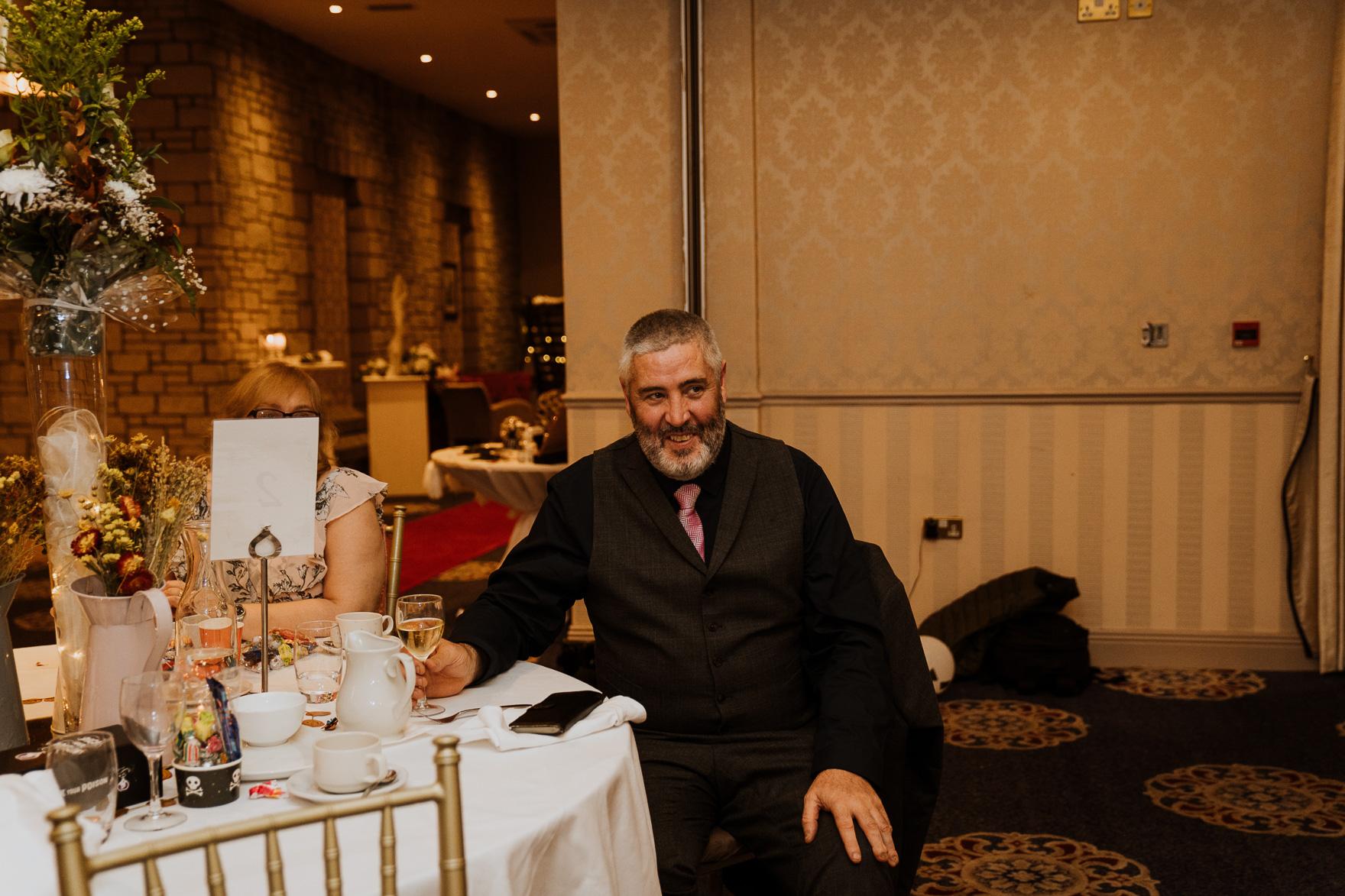 Wayne Cochran sitting at a table