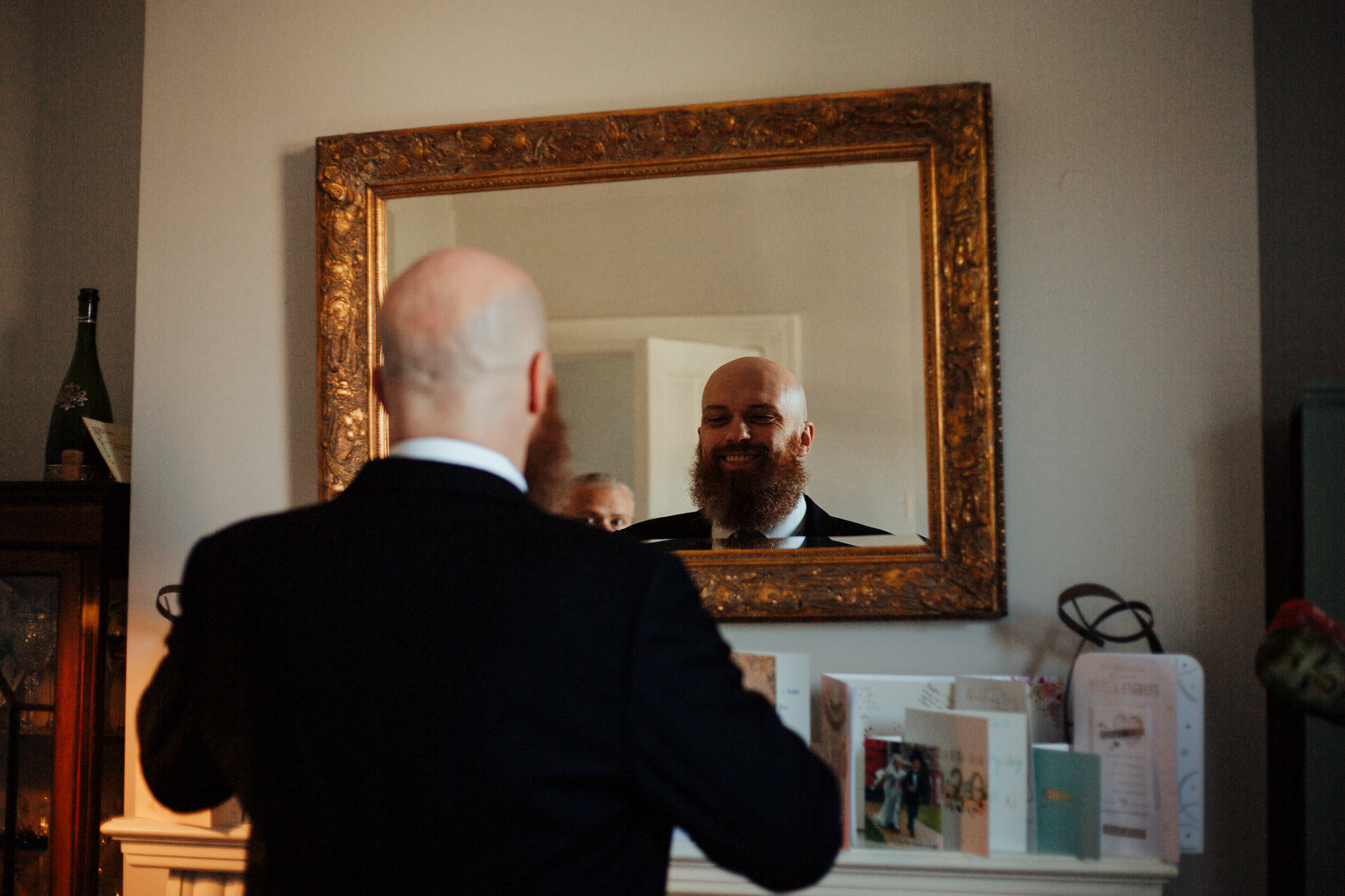 A man standing in front of a mirror posing for the camera