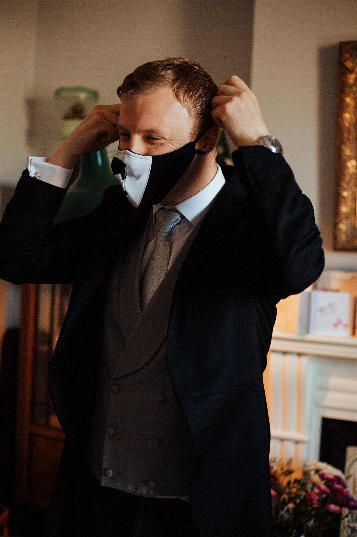 A man wearing a suit and tie talking on a cell phone