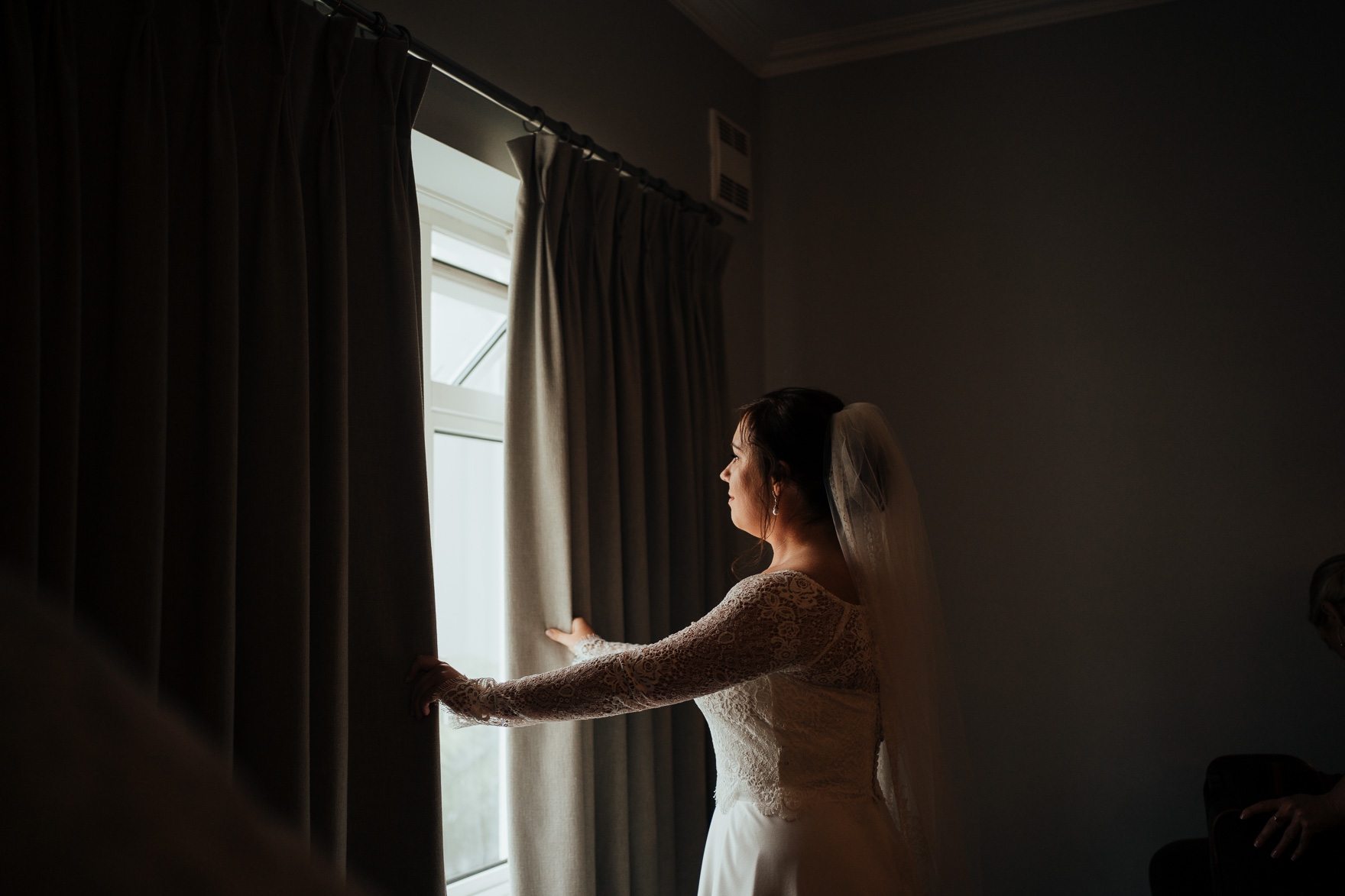 A person standing in front of a window