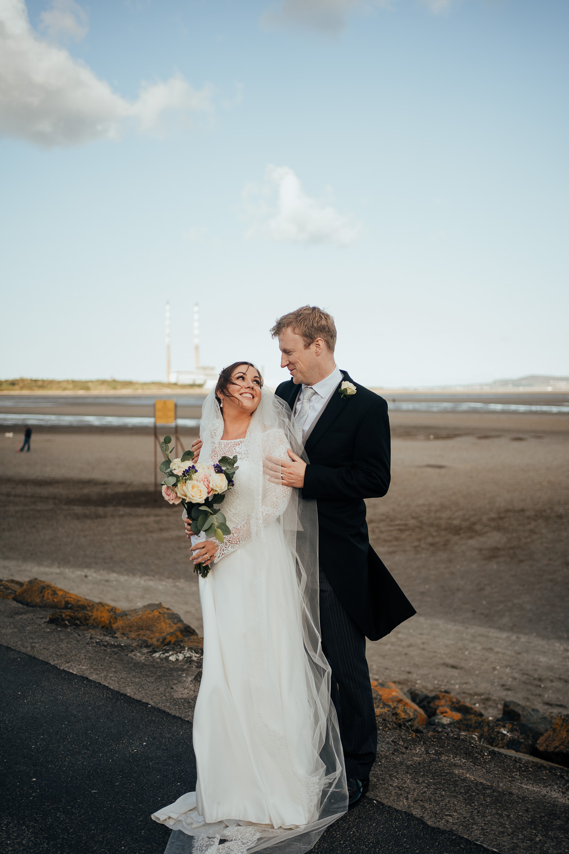 A man and a woman standing on a beach