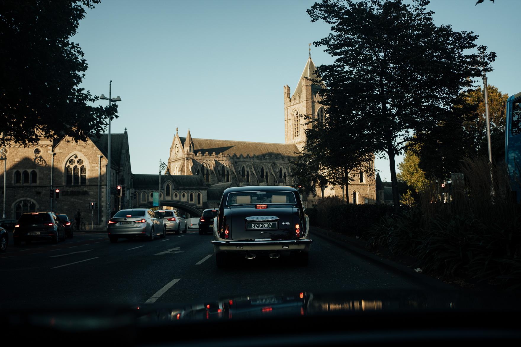 A car driving down a street