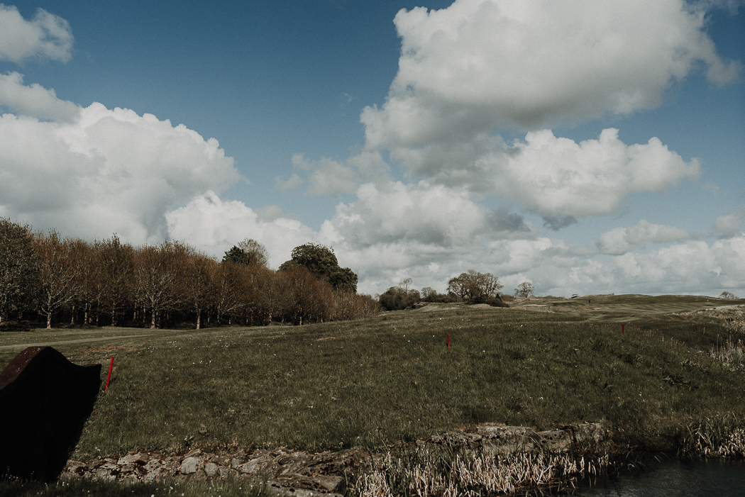 A field with clouds in the sky