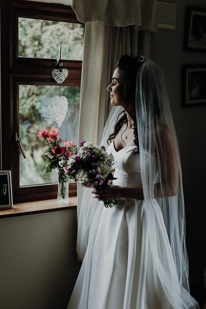 A woman wearing a wedding dress
