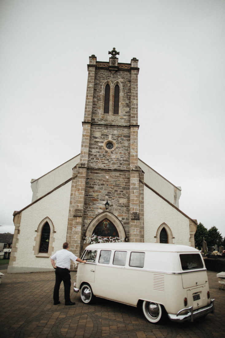 A truck is parked in front of a church