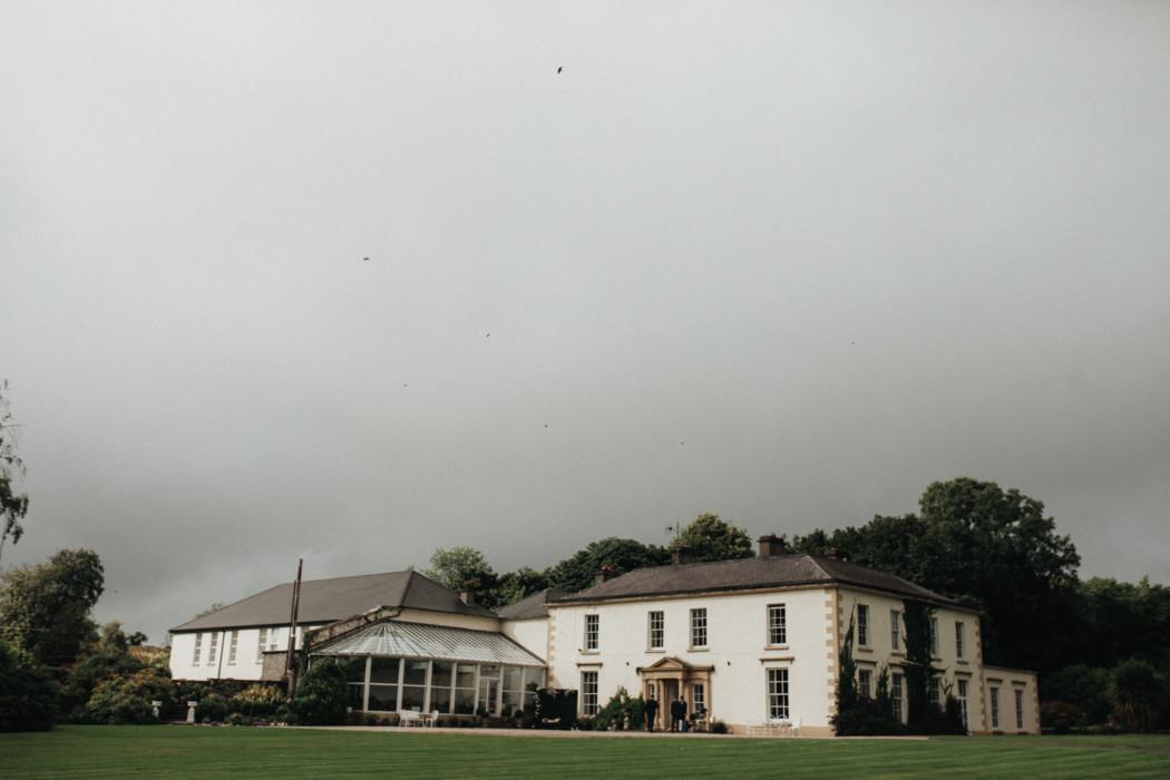 A house with a cloudy sky