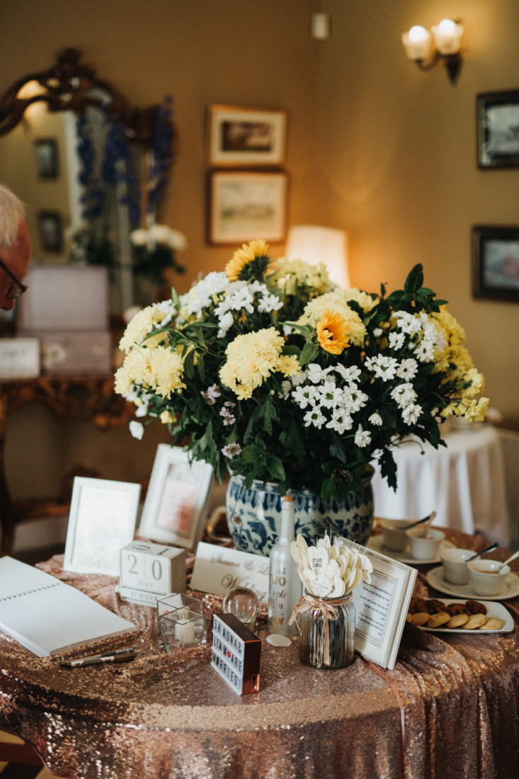 A room filled with furniture and vase of flowers on a table