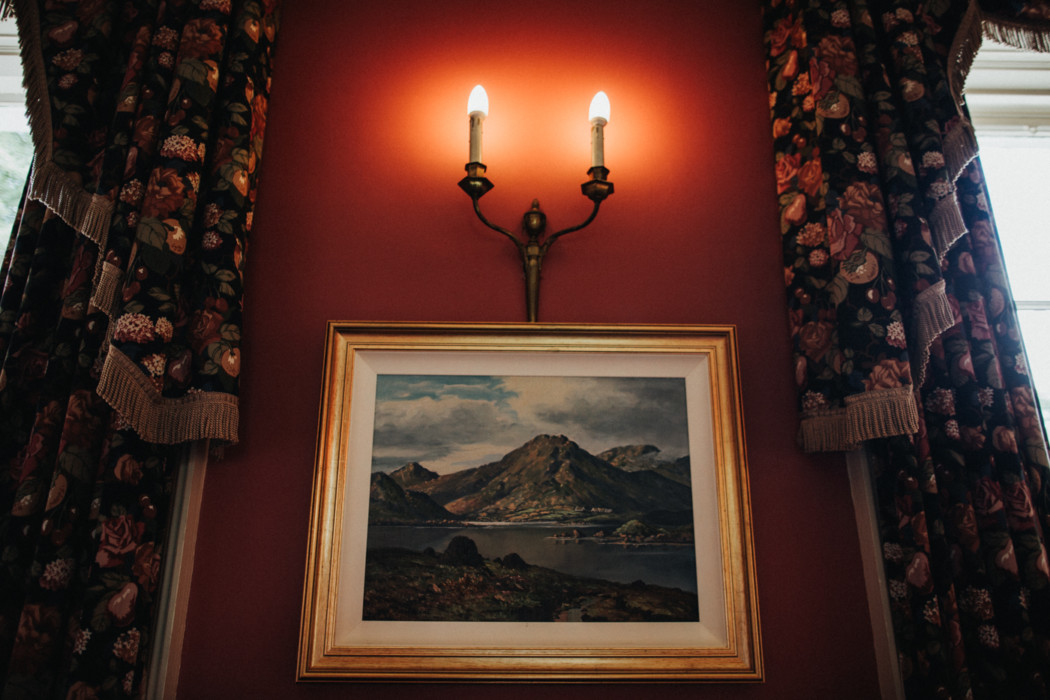 A painting on the corner of a room