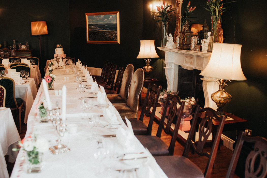 A dining room table filled with wine glasses