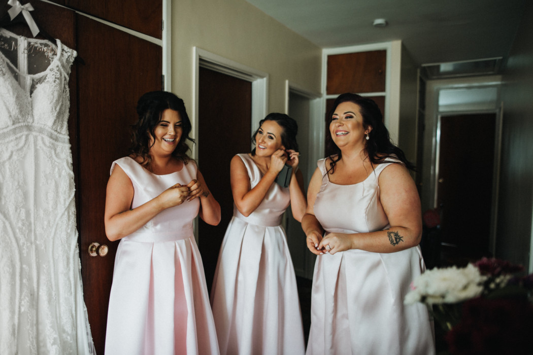 A couple of people that are standing in a wedding dress