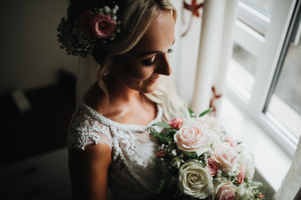 A woman wearing a wedding cake