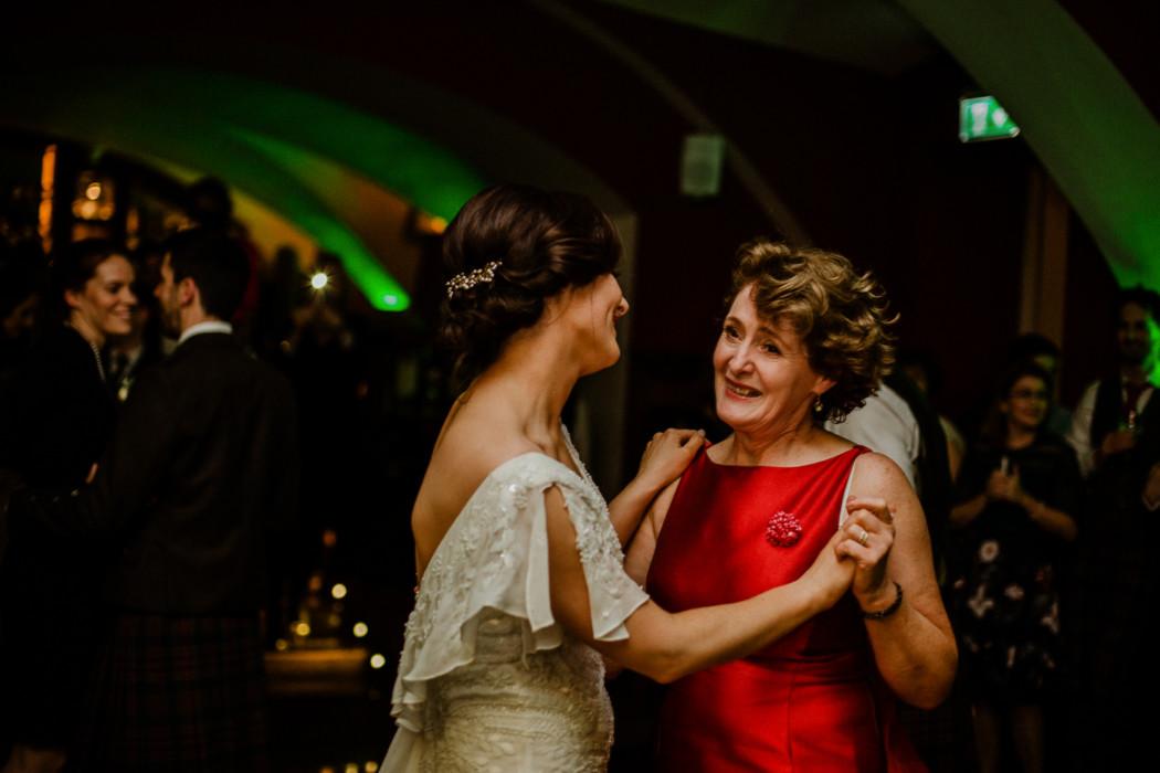 Marjorie Merriweather Post standing in front of a wedding dress