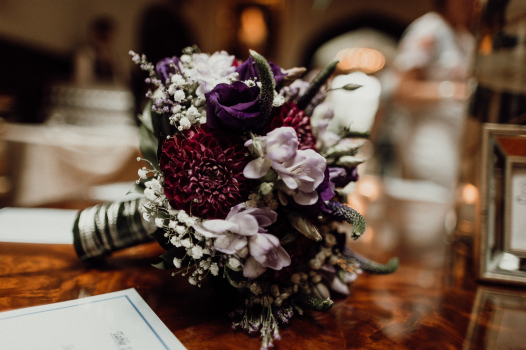 A close up of a vase of flowers on a table