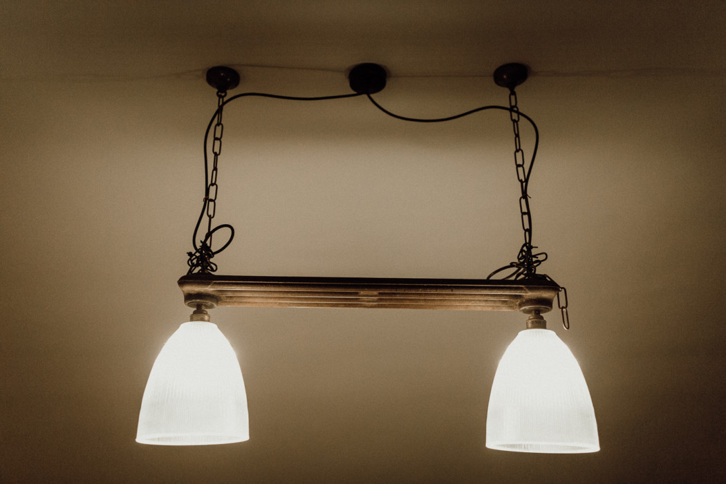 A lamp that is hanging on a wall