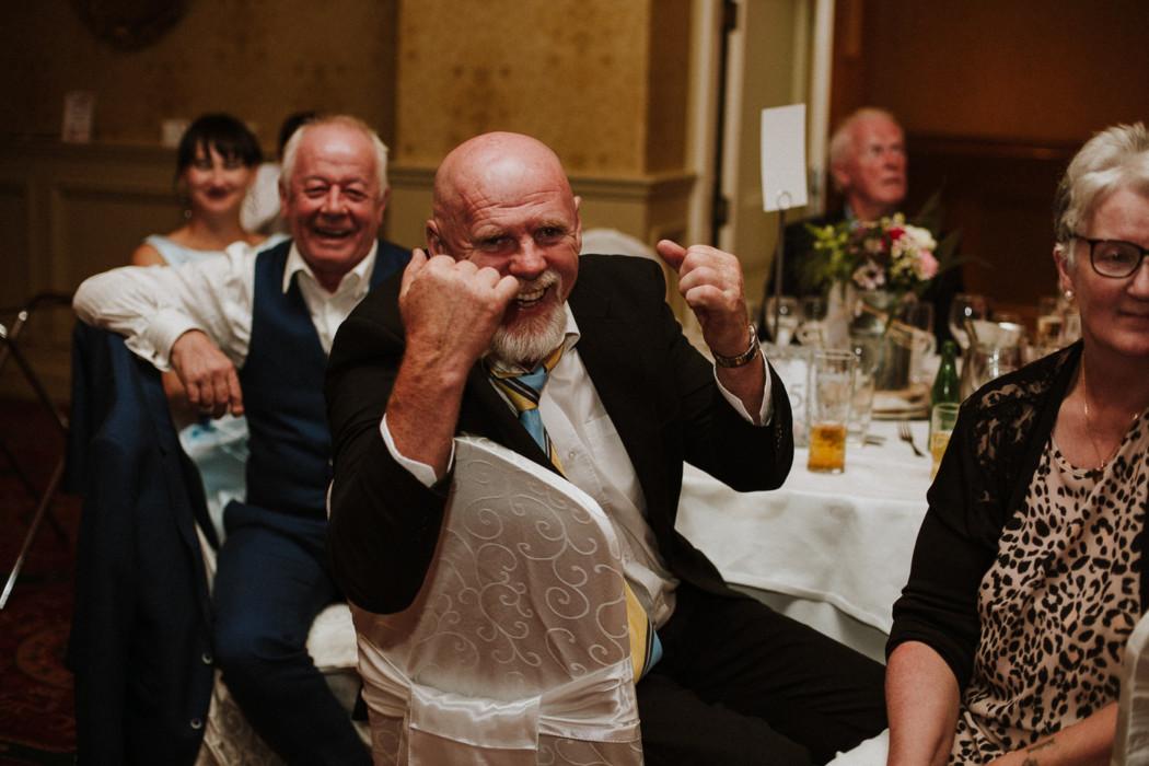 Necmettin Erbakan et al. holding wine glasses